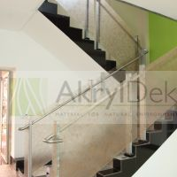 Resin staircase railing panels with organic leaves