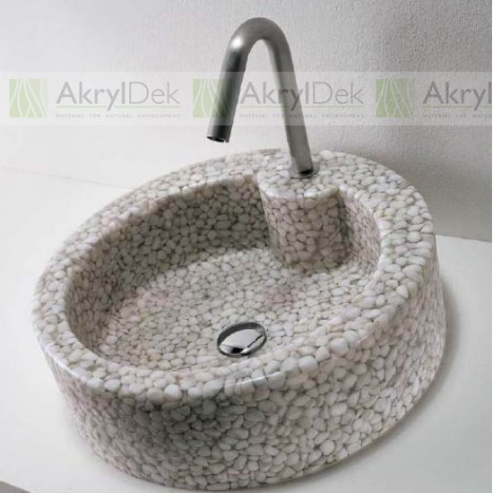Wash-basin and sink made of pebble stone in resin