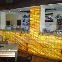 Backlit onyx bar panelling